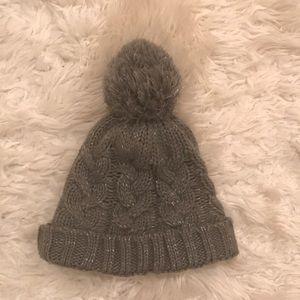 Cableknit grey and silver pom pom hat
